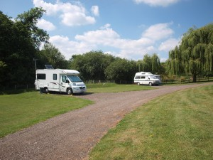 Motorhomes and caravans at Luccombes Fishery